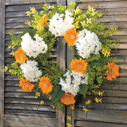 Grandin Road - Eden Garden Wreath - Cheerful, colorful wreath made of artificial springtime flowers. Radiating forsythia branches enhance the size and dimension of the wreath. Display indoors or in a sheltered outdoor area. Capture the joy of spring any time of year with our Eden Garden Wreath. Sprigs of forsythia-that early-blooming flower that heralds the season-radiate outward, enhancing its beauty. Plump hydrangeas, orange daisies, and mixed greenery complete the look. Beautifully crafted of lifelike materials that will last for years.  .  .  . A Grandin Road exclusive.