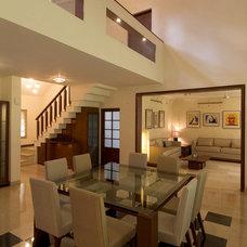 Modern Dining Room by AjjC Design