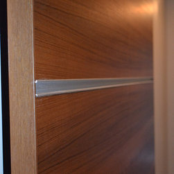 Doors and Trim - This is a quartersawn teak veneer door with aluminum extrusion details.  It's hung on black sliding hardware.