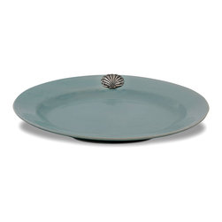 Coquille Oval Platter - Mist - Grand yet sensible, the Coquille Mist Oval Platter has a simple, self-contained shape and a breathtaking pewter scallop medallion which brings out the grey tones in its exquisite, cloud-colored glaze.  This platter is perfect for starting a collection of robust, timeless serveware, accented as it is with the most traditional of metals and glazed in a lovely blue-grey.