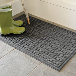Recycled Water-Guard Mat - This mat is made from rubber tires and will instantly absorb water — perfect for the wellies!