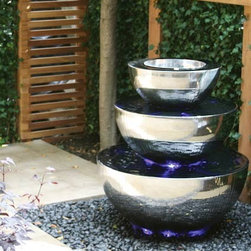Three Tiered Chalice Water Feature - This impressive chalice-style water feature for the garden cleverly gives the impression that the bowls rotate when they're actually static.