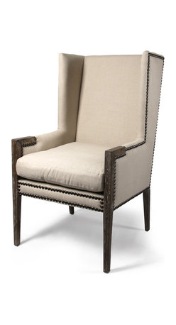 Linen Nailhead Wing Chair - The Linen Nail head Wing Chair is transitional and current in design and yet has the comfort of the wing chairs of yesteryear. The neutral linen fabric and traditional nail head trim makes this chair assimilate into a variety of environments and the perfect choice whether paired with a sofa or tucked away in your favorite place to read.