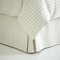 Ballard Designs - Ticking Stripe Bedskirt - Coordinates with our Ticking Stripe Duvet & Sham. Machine washable. When we found our vintage Ticking Stripe fabric, we knew it belonged in the bedroom. The Bedskirt is hand finished in 100% cotton with split corner kick pleat and center pleat for a crisp, tailored look perfect for guest or boy's room. Ticking Stripe Sham features: . .
