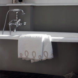 Comforting and Luxurious Bath Details - Subtle trim details like scalloped edging that match your bath mat make your bathroom extra special.