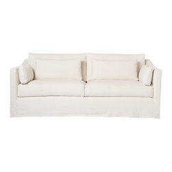 "Kathy Kuo Home - Rebecca Denim White Coastal Style Slip Cover Sofa - 84"" - Keep it simple and you can't go wrong.  This design philosophy is perfectly embodied in the clean lines and easy attitude of this sofa.  Available slipcovered, this comfortable classic works in a multitude of spaces and traditions.  Upholstered in denim white, this sofa can also be covered in whatever fabric you choose. The possibilities are endless and the guarantee on the frame is for life.  Includes two (2) x 10 x 20, two (2) x 14 x 29 feather down loose cushions.  Sectional and Chaise version available - please contact us for details."