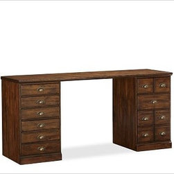 "Printer's Desk Set, Tuscan Chestnut stain - A vintage printer's cabinet with dozens of small drawers for storing type was the inspiration for our newest home office collection. Designed for ultimate versatility - at an exceptional value - its components can be combined in any configuration to create your perfect workspace. 64"" wide x 20"" deep x 30"" high The Desk Set includes one file cabinet pedestal, one cabinet pedestal, and one quadruple top. The file cabinet pedestal has three bluff-cut drawers; bottom drawer is fitted with rails for both letter- and legal-sized hanging folders. The cabinet pedestal has a bluff-cut door and two removable shelves. Pedestals are interchangeable and can be placed on either side of the desk as desired. The Tuscan chestnut finish is hand applied in layers, with distressing and burnished edges that give the collection the look of a well-loved antique. Fitted with antique bronze cup pulls. Wood swatches, below, are available for $25 each. We will provide a merchandise refund for wood swatches if they're returned within 30 days. Watch a video about the versatility of our {{link path='/pages/popups/printers_video_popup.html?cm_sp=Video_PIP-_-PBQUALITY-_-PRINTERS' class='popup' width='450' height='300'}}Printer's Collection{{/link}}. View our {{link path='pages/popups/fb-home-office.html' class='popup' width='480' height='300'}}Furniture Brochure{{/link}}."