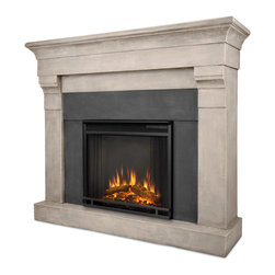 Torrence Cast Cinder Stone Electric Firebox & Mantel - The Torrence Mantel features an elegant, classic design and authentic stone texture, creating a beautiful built-in look to compliment any room. Real Flames Cast Mantels are crafted from a lightweight, fiber-enforced concrete and backed with an internal steel frame for an enduring presence. For safety, this unit must be anchored to a wall using the included hardware. The Vivid Flame Electric Firebox plugs into any standard outlet for convenient set up. The features include remote control, programmable thermostat, timer function, brightness settings and ultra bright Vivid Flame LED technology.