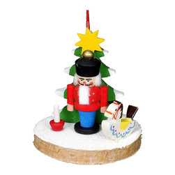 Alexander Taron - Christian Ulbricht Ornament - Nutcracker with Tree and Toys - 2H x 2W x 1.75D - Christian Ulbricht hanging ornament - nutcracker with candle and rocking horse in front of Christmas tree - made in Germany.