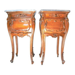 Used Antique French Rococo Walnut Nightstands - A Pair - A pair of antique French bedside commodes or nightstands. They have stunning marble tops which are in perfect shape. These nightstands, particularly in a pair, have become rather hard to find. These gorgeous commodes have all the right components. First, the walnut construction is impeccable. The intricate carved details on the face of the pieces and on the legs is beautiful and in magnificent condition. Each piece has a small drawer and a cabinet door underneath which opens to a marble lined interior. These nightstands are French, circa late 1800s.