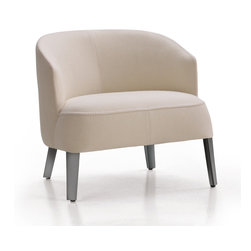 Maxalto - Maxalto Febo Armchair - The Febo family is completed by four elegant armchairs distinguished by their back heights. These are available in single material, in fabric or leather, with visible blanket stitch, with painted legs with bright chromed, bronzed nickle finish or with a wooden base-frame in a wide range of finishes; grey oak, brushed light oak, brushed black oak or smoked stain oak. Price includes delivery to the USA. Manufactured by Maxalto.
