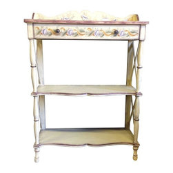 """Used Seashell Painted Shelves - This vintage display shelf features one drawer and is finished in a yellow base with painted seashell decorations on the scalloped apron and drawer front. It has an X-detail on the side and ample shelf height for tall things. The shelf was found a while ago in the SF Henredon showroom. The sticker on the back is from Ardley Hall.     The shelf measures 30"""" wide 42"""" to top of apron 13"""" deep. It is close to 14"""" high with space between the shelves."""