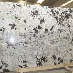 Alaska White - Beautiful white granite with - Brown granite with large extrusion - suitable in modern as well as traditional kitchen. Also known as Ice Brown,  It is quarried from Brazil