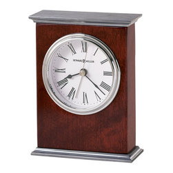 Howard Miller - Howard Miller Kentwood Alarm Clock - Howard Miller - Alarm Clocks - 645481 - This contemporary carriage table clock has a radiant character and will be an attractive fixture on any mantel or table top. Distinguished by its polished nickel crown and base and matching dial bezel on a classic white dial the Kentwood has a real gleam to it. Beautiful hardwood framing in a rosewood finish and quality quartz movement operation complete the look and appeal of this accent clock.
