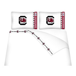 Sports Coverage - Sports Coverage NCAA South Carolina Gamecocks Microfiber Hem Sheet Set - Full - NCAA South Carolina Gamecocks Microfiber Hem Sheet Set have an ultrafine peach weave that is softer and more comfortable than cotton. Its brushed silk-like embrace provides good insulation and warmth, yet is breathable.   The 100% polyester microfiber is wrinkle-resistant, washes beautifully, and dries quickly with never any shrinkage. The pillowcase has a white on white print beneath the officially licensed team name and logo printed in vibrant team colors, complimenting the new printed hems.    Features: -  Weight of fabric - 92GSM ,  - Soothing texture and 11 pocket,  -  100% Polyester,  - Machine wash in cold water with light colors,  - Use gentle cycle and no bleach ,  - Tumble-dry,  - Do not iron ,