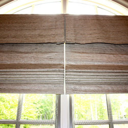 Hanging In Style Designs - Hand made Roman Shades with two shades on one headrail.  Raw Silk was used to complement the copper bathtub.