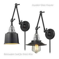 Insulator Glass Wall Sconces - This Insulator Glass collection was inspired by the glass relics that adorned the top of telegraph lines at the turn of the 20th century. Acting as the centerpiece of this series is the recognizable shape of the glass insulator. Made from thick clear glass that is complimented by solid cast hardware designed with an industrial aesthetic. Available in polished chrome, oiled bronze, and weathered zinc finish. (Accommodates standard medium base bulb(s) - Edison bulb(s) not included)