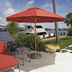 "FiberBuilt Augusta 11-ft. Fiber Teak Contract Patio Umbrella - The Augusta 11-Foot Contract-Grade Patio Umbrella will bring you more shade that you thought possible. Whether for your patio or pool area this umbrella will withstand the weather as well as the family. This umbrella features a larger pole diameter of 1.75 inches making it an ideal choice for freestanding applications. Made to commercial specifications this umbrella has eight ribs of fiberglass that sway with wind gusts instead of falling over. The one-piece aluminum pole is available in a FiberTeak simulated wood pole finish. This 1.75-inch-diameter pole looks and feels like real wood but it is stronger and more durable. The corresponding hardware is stainless steel. The solid wood hub will provide years of smooth operation. With an umbrella of this quality you can be confident that it will stand up to the test of time. Umbrella pole has a 1-year warrantyFiberglass ribs have a 3-year warrantyMarine-grade Sunbrella fabric has a 5-year warranty against fading The Augusta umbrella is shown above with a double wind vent shade this item is currently only availble with a single wind vent. The Augusta 11 Foot Contract-Grade Patio Umbrella will give you more shade for more fun this summer.This umbrella has break-resistant fiberglass ribs that allow the shade to flex in stronger wind conditions. It has been tested in winds over 50 mph. Fiberglass ribs are 4 times stronger and up to 30% lighter than traditional wood or metal ribs.The Augusta umbrella offers a 1.75 inch pole. This may not fit through a hole in your patio table. The hole in your table needs to measure at least 2 inches for this umbrella to fit. Need a smaller pole? The 11ft Bridgewater Umbrella offers a 1.5 inch pole.More About FiberBuilt Umbrellas FiberBuilt Umbrellas is dedicated to manufacturing state of the art fiberglass ribbed umbrellas for use at hotels condominiums country clubs and restaurants as well as many other locations requiring contract quality products. The unique fiberglass support rib construction ensures strength resilience and durability. FiberBuilt has developed unique lines of contract quality Beach Garden and Market umbrellas that will hold up to the harshest weather conditions. Umbrellas constructed with Marine Grade fabric will withstand intense sunlight salt air and driving rain. About SunbrellaSunbrella has been the leader in performance fabrics for over 45 years. Impeccable quality sophisticated styling and best-in-class warranties prove the new generation of Sunbrella offers more possibilities than ever. Sunbrella fabrics are breathable and water-repellant. If kept dry they will not support the growth of mildew as natural fibers will. Beautiful and durable Sunbrella is a name you can trust in your outdoor furniture.Cleaning and Caring for SunbrellaRegular maintenance is the best way to keep your Sunbrella fabrics looking good and delay deep vigorous cleaning. Brush off dirt before it becomes embedded in the fabrics and wipe up spills as soon as they occur. For light cleaning use a mild soap and water solution and a sponge allowing your cleaning solution to soak into the fabric. Rinse thoroughly to remove all soap residue and allow fabric to air dry. For more specifics on maintaining Sunbrella fabrics visit Sunbrella.com.Sunbrella fabrics have been tested to provide up to 98% UV protection depending on depth of color. Whites and lighter colored fabrics provide less protection than darker fabrics. This protective factor is inherent to the product and will not diminish through use or exposure to the sun. Sunbrella furniture and umbrella fabrics have been awarded the ""Seal of Recommendation"" by the Skin Cancer Foundation an international organization dedicated to the prevention of skin cancer. Beautiful and protective fabric is the hallmark of Sunbrella."