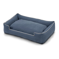 Crypton Blueberry Pet Lounge - 32x27 - Perfect for humid climates and water-loving dogs, the moisture-resistant fabric of the Crypton Blueberry Pet Lounge repels stains and endures dirt and use, allowing it to stay fresh between machine-washings.  The look of this pet bed is as desirable as its durability, though, as its cheerful medium blue hue is defined with crisp white piping for a clean transitional look.