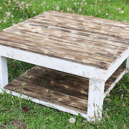 The Shabby Farm Reclaimed Pallet Wood Coffee Table - The Shabby Farmhouse is a rustic and beautiful table with rich tones of browns and greys highlighting all of the natural scruffs and scrapes of the wood. The top of the table has a clear coat of water-based poly which brings out the character - and keeps it spill resistant! The frame of the table is finished with a white distressed chalk paint and has an added shelf for storage that is perfect for baskets or bins.