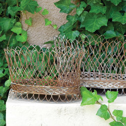 "Nested French Wire Baskets (Set of 2) - Featuring an intricate wire design, our set of 2 nested metal French country baskets will add a special touch of sophistication to your entryway, kitchen, dining room or garden area. Display decorative balls, potted plants, and linens, or use for holding fruit and breads at mealtime. A home and garden collection selected that bring happy memories of childhood past. Whether you are looking for period charm, a style of elegant restraint or just want to infuse a spirit of playfulness, you'll find it here. Dimensions: (Sm) 13.5"" x 10"" x 8"" (Lg) 13.5"" x 10"" x 8"""