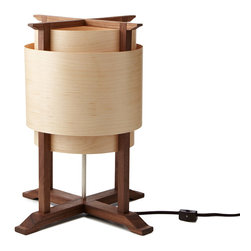 Rustic Wooden Handmade Wrap Lamp - A beautiful blend of fine craftsmanship and modern design, this handmade lamp brings a sleek, natural touch to your home. Topped with a shade made from paper-backed maple veneer, this solid black walnut luminary is highlighted by unique wood grain textures and a two tone palette. A gorgeous touch next to your bed, sofa, or desk, this eye-catching piece brings the classic appeal of wood design home. Handmade in Virginia