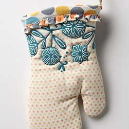 "Dotty Match Oven Mitt - Ruffles aren't usually my thing, but I always appreciate a little fun in the kitchen. That and the pretty colors in this charming mitt would make it a welcome addition in my home.Dimensions: 12.5""L, 6.5""W. Made of cotton."