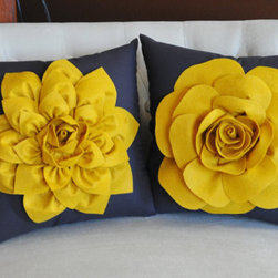Decorative Flower Pillows, Mustard Yellow by Bed Buggs - Who wouldn't want to sit down with these beauties? I love the gorgeous yellow color and detail. I have a white chair that is begging for them.