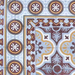 Cuban Heritage Design - This cement tile has a great 'rug' pattern in its design, and lovely light blue is a color that can really lift a dark entryway. The colors are a bit more muted so it would work well with any interior. Tiles like this transition really nicely with wood floors.