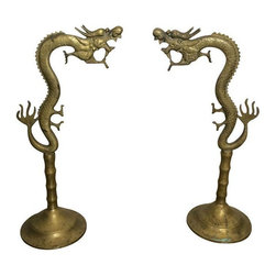 Used Antique Brass Incense Burner Dragons - Incredibly rare and unique pair of incense burning dragons. Made of brass, of an origin unknown. We've never seen anything like these.The incense cone you'd place on a small tray under the base. Within seconds, the incense saunters out of the dragons mouth. A conversation piece for sure.