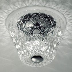 """Leucos Lighting - Atelier PL 32 Flushmount by Leucos Lighting - Appearing as a fine cut diamond, the Gallery Vetri d'Arte Atelier PL 32 Flushmount features hand blown crystal that has been carefully etched to create a stunning piece for the dining room or entry. From the Italian word for """"workshop"""", the Atelier PL 32 displays an attention to detail only seen in the most refined and luxurious pieces.Gallery Vetri d'Arte, an Italian lighting boutique, combines traditional glassmaking and timeless design with an adventurous sense of the modern. Collections from Gallery Vetri d'Arte  include unique chandeliers, wall sconces, and table lamps that seamlessly blend old world  with contemporary. Part of the FDV Collection.FDV Group in Venice, Italy, has joined numerous Italian lighting design companies together under one roof. As such, they are able to provide a wide range of innovative, contemporary designs conceived by distinct brands with long-standing traditional values of quality Italian glassmaking and universal design.The Gallery Vetri d'Arte Atelier PL 32 Flushmount is available with the following:Details:Hand-made Clear crystal blown glass shadeMetal supportsRound ceiling canopyChrome finishUL ListedMade in ItalyDesigned by ArchirivoltoLighting: Three 60 Watt 120 Volt Type E26 Incandescent lamps (not included).Shipping:This item usually ships in 2-3 days."""