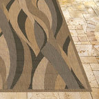 Frontgate - Seascape Outdoor Rug in Brown & Black - Made from 100% fiber-enhanced Courtron  polypropylene. All-weather rug construction is pet-friendly and mold- and mildew-resistant. Power-loomed flat weave makes it suitable for both indoor and outdoor use. Adds warmth underfoot in cooler temperatures and relief from hot surfaces in summer. Simply hose off outdoor rug to clean. A flowing conglomeration of shapes in neutral tones make up our Seascape Outdoor Rug. Weather-defying and designed to complement classic outdoor decor, this versatile floor covering infuses entryways, patios, and sunrooms with soothing colors.Made from 100% fiber-enhanced Courtron polypropylene. . . . . Made in Belgium.