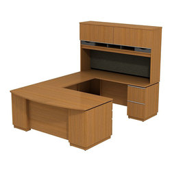 "Bush - Bush Milano 2 72"" Right-Hand U-Shape Desk with Hutch in Golden Anigre - Bush - office Sets - MI2026RGA - Welcome to your new office. For doing your job well you've earned the freedom and means to express your personal taste. Milano 2 appeals to your practical side and looks good doing it. The right-handed Bush Milano 2 Line Harvest Cherry or Golden Anigre 72""W RH U-Station adds polish to any executive suite. Its ""U"" configuration created by a 42""W Bridge mounted between 72""Bowfront Double Ped Desk and 72""Single Ped Credenza offers ample room to spread out. One side has three drawers (B/B/F) to hold files or office supplies. Secure lockable file pedestal has two drawers to hold letter- legal-or A4-size files. Full extension ball bearing slides allow easy access to back of drawers. Tall 72""W Overhead adds cabinets with flip-up doors that remain open. Full-width fabric covered tack board holds pictures messages and more. Open work-in-progress compartments are accessible via wooden paper storage trays. Accepts task lighting for integrated visual appeal. Extruded aluminum door and drawer pulls are sturdy tasteful and contemporary. Back panel cutout for wire management conceals unsightly cords and cables. Pencil Drawer or Keyboard Shelf (optional) provides extra versatility. Diamond Coat top surface resists scratches abrasions and stains. Durable edge banding protects against bumps dings and dents. Rugged good looks combined with traditional styling and value make a classic statement in any executive office. Includes Bush limited Lifetime warranty."