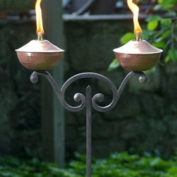 """Inspiration Torch Brushed Copper - SS-10PM - Spirit Stakes™ Torches add a dramatic focal point for entertaining outdoors with """"flare""""! This Inspiration double torch is crafted in Brushed Copper and includes a long-lasting fiberglass wick and Copper snuffer. Holds 8 oz. for approximately 12 hours burn time. The stakes are made of durable hand-forged iron which come apart for easy shipping, assembly and storage. 14 1/2"""" W x 72"""" H. As part of the Spirit Stakes Collection you can create unique garden structures and encourage climbing plants by combining with a Hoop or Heart trellis – sold separately."""
