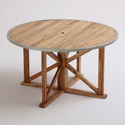 Round Antigua Outdoor Dining Table - Don't forget a dining table for outdoor entertaining. This round rustic one is beautiful and works well outside.
