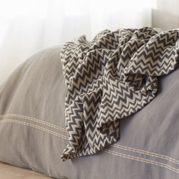 Zigzag Matelasse Throw - Rich color and organic texture give our coverlet irresistible character. Evoking a vintage knit, its matelassé is woven from chunky yarn-dyed cotton for a feel that's weighty and comforting, yet open and breathable. Hemmed knife-edges.