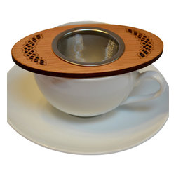 MoonSpoon® - Tea Nest, Celtic Design - From Oolong to chamomile, you can steep in style with this tea strainer. The gorgeous wood features a flame design, and keeps the tea hot and your fingers cool. The stainless steel basket lifts out for easy cleaning.