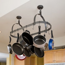 """Rack It Up Oval Pot Rack - The classic choice for most kitchens the Enclume Rack It Up Oval Pot Rack is full-sized and spacious so you'll have all the room you need for your favorite pots and pans. With its traditional oval shape and simple style this basic pot rack is exactly what you need to make your kitchen feel modern large and clean. Twelve hooks are included to maximize your rack usage. Made of thick high-capacity steel this pot rack has a durable simulated hammered steel powder-coated finish but can also be easily spray painted any color to match your decor.Pot racks free up countertop and cabinet space to keep your kitchen clutter-free and organized. Enclume's new Rack It Up! pot racks are designed for the smaller kitchens of the average middle-America home or apartment and are a cost-effective way to upgrade or organize your space. In minutes these practical pot racks easily install on drywall with super-strong new technology anchors eliminating the need to search for joists or studs. Perfect for your first pot rack these affordable and compact pieces feature the esteemed Enclume name and are superior in quality to other similarly priced brands.About Enclume Design Products Inc.Enclume Design Products Inc. is an esteemed manufacturer of cookware storage racks with products that set the industry standards for quality design function and strength. Fine """"pot racks"""" have been the company's specialty since its founding in 1973 as a metal crafting company. Based in Port Hadlock Washington Enclume applies time-honored methods that have been used by master craftsmen for centuries. Their durable and practical ironwork products add style grace and organization to your kitchen hearth and home. Enclume has expanded its product line to include kitchen furniture hearth products finishing touches and accessories all made with the same care and innovation as their legendary pot racks."""