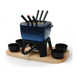 """Swissmar - Mont Blanc 15 Piece Meat Fondue Set in Blue - Why not have a fondue party this weekend. This classy fondue set even includes ceramic dishes for dipping sauces. Made of sturdy enameled cast iron and is best suited for meat fondues but by removing the spatter guard you can make cheese or chocolate fondues. Also great for serving one pot meals such as chili con carne, cheesy nacho sauces, veggie dips, Swedish meatballs, or hearty soups. The set includes: -Blue Square Pot. -Spatter Guard. -Rechaud with Wood Base. -Four Black Ceramic Dipping Dishes. -6 Meat Fondue Forks. -Single function burners used with liquid gel. Features: -Color: Blue. -Pot is enamelled inside and provides even heat distribution. -Best suited for meat fondues but can be used for cheese or chocolate fondues. -Easy to clean. Specifications: -Dimensions: 8.5"""" H x 8.75"""" W x 15.75"""" L. -Capacity: 64 oz.. -Material: Cast Iron Ceramic Wood."""