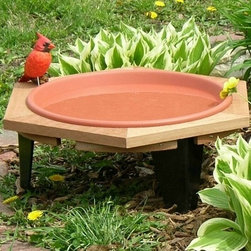 Songbird Essentials - Classic 17 Garden Bird Bath - Classic 17 garden bird bath sets 8 inch high off your flower garden. Comes with a clay colored pan that is 1 5/8 inch deep. Some assembly required.