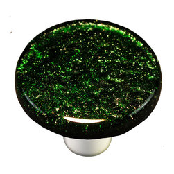 "Aquila Art Glass - Metallic Green Knob Round, Black Post - To make our cabinet knobs and pulls, 2 to 5 pieces of glass are cut, cleaned, stacked together and placed into a kiln. The kiln goes up to 1450 degrees Fahrenheit, the glass becomes molten and fuses together to make one piece of glass. The glass is then cut out out to the required shape. Next the glass is placed back into a kiln and taken to 1300 degrees fahrenheit and the edges are ""fire polished"". The glass spends about 48 hours in the kilns. Expect slight variations in color & size."