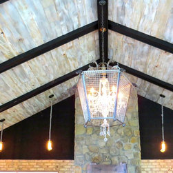 """Cloud9"" Eastern White Pine Ceiling Planks - Did you ever sit and stare up at the sky until you were totally entranced by the clouds? Now you can enjoy that mesmerizing feeling anywhere in your home with our Cloud design ceiling planks. We start with a lightweight Eastern White Pine and mill it to 1/2 in. thickness. We bevel the edges and lightly sand the surface, taking care not to disturb any of the original character such as saw kerfs, etc. Our craftsmen then strategically finish with our special blend of gray, cream and white paints to mimic the sky on a cloudy day. With the right lighting, our Cloud design ceiling panels will captivate your family and friends!"