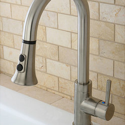 None - Kitchen Satin Nickel Single Handle Faucet with Pull Down Spout - This pull-down faucet features a gooseneck-shaped spout which hangs over the sink built for easy washing. The long coil covering part of the sprayer is connected to the neckpiece for support.