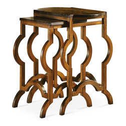 Baker Furniture - Nesting Tables - Just prior to the turn of the century, gracious hosts pampered their guests with refreshments served chair-side on small nesting tables. A whimsical nest of tables blends this 18th century notion with 20th century design. With free-form legs and a keystone-shaped top on the larger table, their aesthetic is Art Moderne.