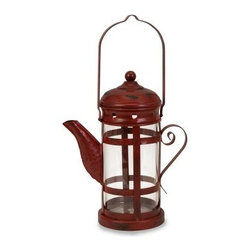 Red Teapot Candle Lantern - Tea time is anytime with the charming-as-can-be Red Teapot Candle Lantern. The tin frame is finished in brick red and features a handle at the top for easy hanging. A clear glass shade completes the look, and the lantern accommodates one pillar candle (not included).About IMAXWhat began as a small company importing copper flower containers in 1984 by Al and Faye Bulak has developed into one of the top U.S. import companies serving the At Home market today. IMAX now provides home and garden accessories imported from twelve countries around the world, housed in a 500,000 square foot distribution center. Additional sourcing, product development and showroom facilities in the USA, India and China make IMAX a true global source. They're dedicated to providing products designed to meet your needs. This is achieved through a design and product development team that pushes creativity, taste and fashion trends - layering styles, periods, textures, and regions of the world - to create a visually delightful and meaningful environment. At IMAX, they believe style, integrity, and great design can make living easier.