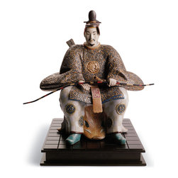 """Lladro Porcelain - Lladro Japanese Nobleman I Figurine - Plus One Year Accidental Breakage Replacem - """" This is a replica of two antique wooden statues from Japan to be found in the Yomeimon Gate at the Toshogu Shrine (city of Nikko, Japan).They represent two Zuishin, noblemen or traditional bodyguards for high rank dignitaries.Zuishin always come in pairs, one standing at each side of the entranceway.They are carrying swords, bows and arrow-holders as their function was to protect their lord, and even his shrine from evil and wrong-doers.These are dressed in old court costume, with their kimono embroidered with the kikyo flower.They are stately seated on a tiger skin. Hand Made In Valencia Spain - Sculpted By: Alfredo Llorens - Limited To: 1500 Pieces Worldwide - Included with this sculpture is replacement insurance against accidental breakage. The replacement insurance is valid for one year from the date of purchase and covers 100% of the cost to replace this sculpture (shipping not included). However once the sculpture retires or is no longer being made, the breakage coverage ends as the piece can no longer be replaced. """""""