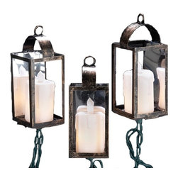 Kurt S Adler - Kurt Adler Antique Brass Lantern 10 ct. LED Light Set Multicolor - UL1876 - Shop for Candle Holders from Hayneedle.com! A beautiful traditional touch for any holiday decor the 10 ct. LED Antique Brass Lantern Set with 12 in. Spacing features 10 brass-colored lanterns with candle-shaped fixtures inside. Lit by clear white LEDs this light set provides soft welcoming light for your get-together.About Kurt S. Adler Inc.The story of Kurt S. Adler Inc. begins after the close of World War II when Mr. Adler tried his hand at exporting general goods. Business grew and European economies flourished so he turned his focus to importing. Ornaments were offered by the 1950s and beautiful handmade angels from East and West Germany found an enthusiastic audience in America. Adler expanded the line to glass ornaments from Czechoslovakia hanging ceiling decorations from Germany and miniature lights from Italy.The next decade Adler started importing holiday decor from the Far East. Colorful snow globes and other animated items became a collector's favorite. In the 1980s and 90s Fabriche santas nutcrackers and other collectibles were ushered in. Recent additions include animatronics fiber optic trees interactive advent calendars and synchronized musical decorations.