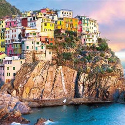 Cliff Hangers Puzzle - 1000 Piece Jigsaw PuzzleImagine homes that are carved and built into the unyielding rock of steep Mediterranean hillsides.  They are as much of things of wonder as     of beauty.  This puzzle captures both, from the view of these brightly painted hillside dwellings to the rich blues and romantic pastels of     the surrounding sea and sky.