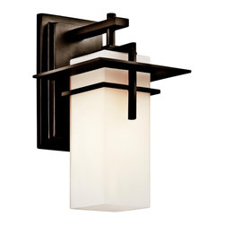 "Kichler - Contemporary Kichler Caterham 11 3/4"" High Outdoor Glass Wall Light - This handsome outdoor wall light features a vertical rectangular shade of beautiful satin etched cased opal glass. A metal frame in warm Old Bronze finish surrounds the glass and attaches to a wall plate also in Old Bronze. A simple yet sophisticated outdoor fixture from Kichler Lighting. Satin etched cased opal glass. Olde Bronze finish metal. Takes one 100 watt bulb (not included). 6 1/2"" wide. 11 3/4"" high. Extends 7 1/4"". UL listed. Backplate is 4 3/4"" wide and 8"" high.  Design by Kichler lighting.  Olde Bronze finish metal.   Satin etched cased opal glass.   Takes one 100 watt bulb (not included).   6 1/2"" wide.   11 3/4"" high.   Extends 7 1/4"".   UL listed.   Backplate is 4 3/4"" wide and 8"" high."