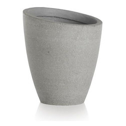 Slant Short Planter - A slight slant to the rim trends these planters from the expected to the delightfully different. Statement pieces flank the door for a contemporary welcome or stage them together, short and tall, for a dynamic display of potted plants. Crafted of a lightweight combination of fiberglass, cement and sand that works indoors or out.